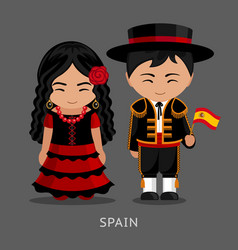 Spaniards in national dress with a flag vector
