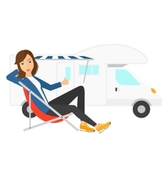 Woman sitting in front of motorhome vector