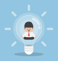 businessman doing meditation inside light bulb vector image