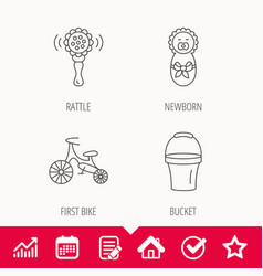 Newborn rattle and first bike icons vector