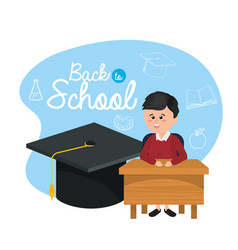 Boy student in the desk with graduate cap vector