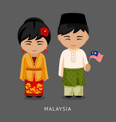Malaysians in national dress with a flag vector