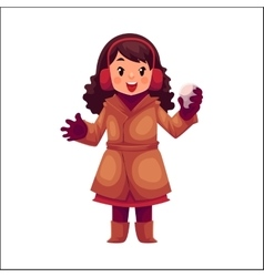 Happy little girl in winter clothes with a vector
