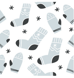 seamless pattern with cute socks and mittens vector image