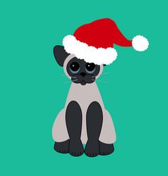 Cat in santa claus hat vector