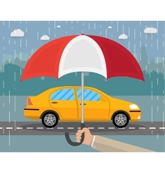 Hand with umbrella that protects car vector image