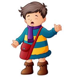 Schoolboy in winter clothes vector