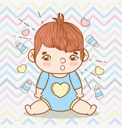 Baby boy with hearts and feeding bottles vector