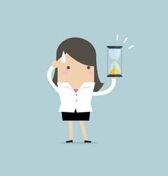 Businesswoman holding sandglass or hourglass vector