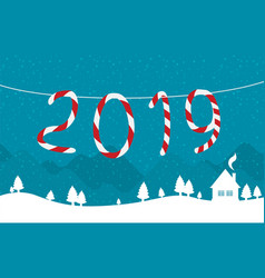 hanging candy canes in snowy winter scene vector image
