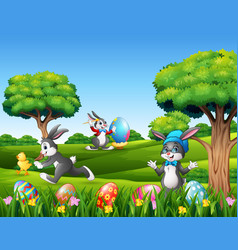 easter bunnies and easter egg on the nature vector image