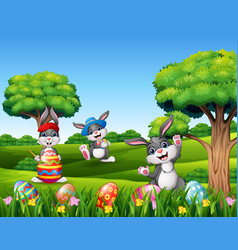 happy easter with bunnies in the nature vector image