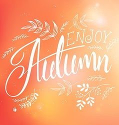 hand lettering label - enjoy autumn - with doodle vector image