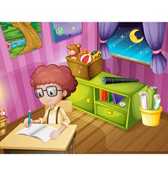 A boy writing inside his room vector