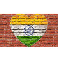 flag of the india in a heart on a brick wall vector image