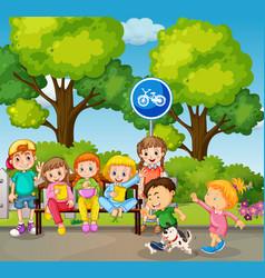 Children playing in park scene vector