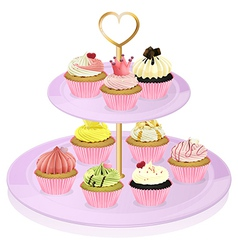 A cupcake stand with cupcakes vector