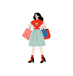 young beautiful woman walking with shopping bags vector image