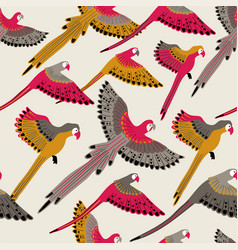 Seamless pattern with flying parrots vector
