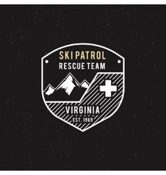 Winter ski patrol rescue team label with vector