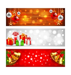 Christmas banners with balls gift boxes and bells vector image