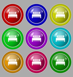 Hotel bed icon sign Symbol on nine round colourful vector image