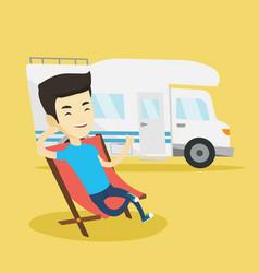 Man sitting in chair in front of camper van vector