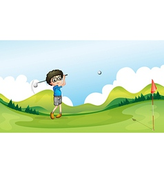 A boy playing golf at the field vector image