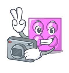 Photographer toy brick mascot cartoon vector