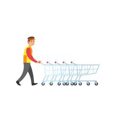 worker man arranging shopping trolleys vector image