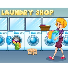 Woman carrying a basket in the laundry shop vector