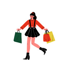 young woman carrying shopping bags with purchases vector image