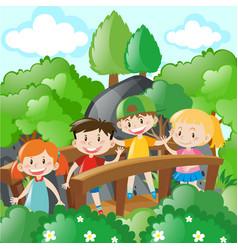 Children standing on wooden bridge vector