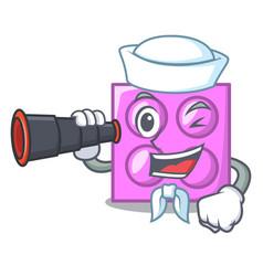 Sailor with binocular toy brick mascot cartoon vector