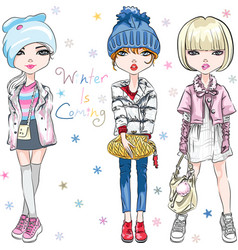 Set fashion girl in winter clothes vector