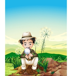 A boy sitting above a stump holding a magnifying vector