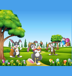 cartoon bunnies holding decorated eggs on easter b vector image