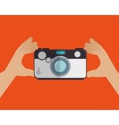 hand holds camera photo orange background design vector image