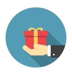 Gift box in hand flat icon vector image