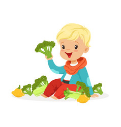 Happy blonde little boy sitting on the floor vector