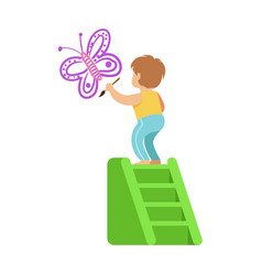 Cute little boy standing on a ladder and painting vector