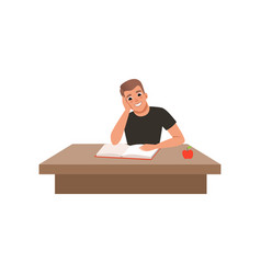 Young man sitting at the desk and reading book vector
