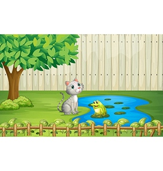 A cat and a frog inside the fence vector image