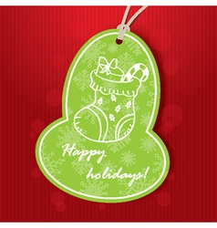 Holiday greeting with green tag vector