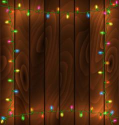 garland frame on wood background vector image