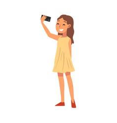 smiling girl wearing yellow dress taking selfie vector image