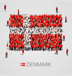 large group of people in the denmark flag shape vector image vector image