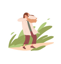 Person standing outdoors while strong wind blowing vector