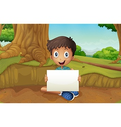 A boy holding an empty signboard near the giant vector image vector image