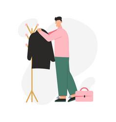 Happy man hangs his coat on outerwear rack vector